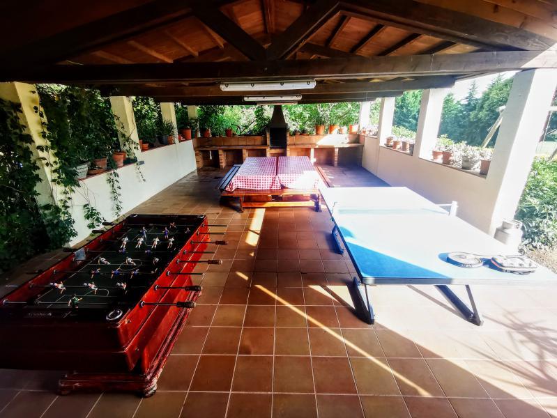 Barbacoa amb ping pong i futbolí gratuït